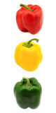 Colorful bell peppers. Red, yellow and green bell peppers in a row Royalty Free Stock Image