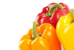 Colorful Bell Peppers. Close up of three colorful Bell Peppers, isolated on white background Stock Photography