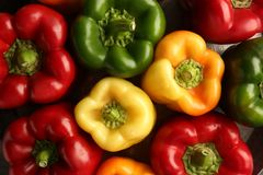 Colorful bell peppers background. Closeup Stock Images