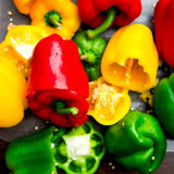 Colorful Bell Peppers on the Chopping Board Royalty Free Stock Photos