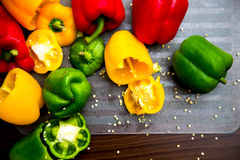 Colorful Bell Peppers on the Chopping Board Stock Photos