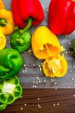Colorful Bell Peppers on the Chopping Board Royalty Free Stock Images