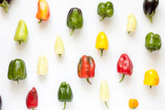 Colorful bell peppers creative arrangement pattern on white Royalty Free Stock Photos