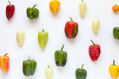 Colorful bell peppers creative arrangement pattern on white Stock Photography