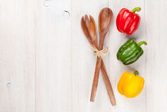 Colorful bell peppers and kitchen utensil Stock Photos