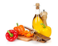 Colorful bell peppers and kitchen utensils Royalty Free Stock Image