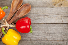 Colorful bell peppers and kitchen utensils Stock Photo