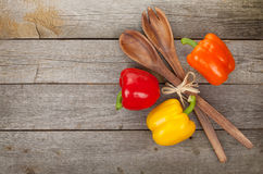 Colorful bell peppers and kitchen utensils Stock Photos