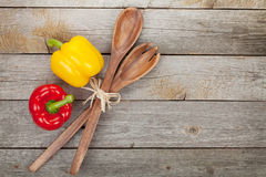 Colorful bell peppers and kitchen utensils Stock Image