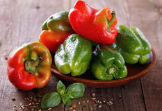 Colorful bell peppers over rustic wooden background Stock Photo