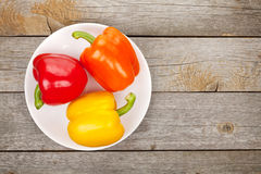 Colorful bell peppers on plate Stock Photos