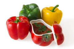 Colorful bell peppers with red ceramic ornament Stock Photos