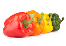 Colorful bell peppers. On white background Stock Photos