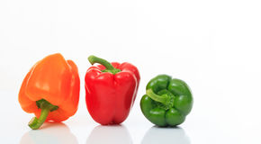 Colorful bell peppers on white background Royalty Free Stock Image