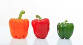 Colorful bell peppers on white background Stock Photos