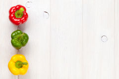 Colorful bell peppers on white wooden table Stock Image
