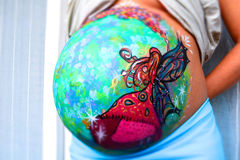 Colorful belly painting Royalty Free Stock Photo