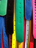 Colorful belts. Several multicolored women belts at local market Royalty Free Stock Image