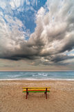 Colorful bench on a beach Stock Images