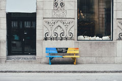 Colorful bench outside city building
