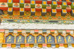 Colorful Bhutan temple roof detail. Beautiful decorations on windows and doors, traditional Bhutanese architecture. Colorful Bhutan temple roof detail royalty free stock photo