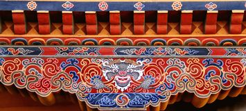 Colorful Bhutanese art of Tibetan dragon painted on wood, Bhutan