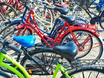 Colorful bicycles parked outdoor city. Colorful bicycles parked outdoor in the city royalty free stock image