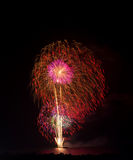 Colorful Big Fireworks from the boat on the sea Stock Photo