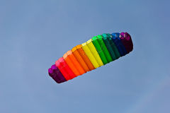 Colorful big kite in blue sky Royalty Free Stock Image