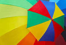Colorful big and small umbrella Stock Images