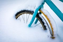Colorful bike covered with snow. stock photography