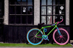 Colorful Bike outside of a Cafe. A colorful bike is parked outside of a cafe Royalty Free Stock Images
