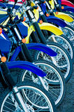 Colorful Bikes. A row of brightly colored motorcycles ready to be sold stock images