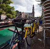 Colorful bikes parked on street in Amsterdam Royalty Free Stock Photo