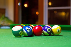 Colorful billiard balls. On the pool table Stock Photos