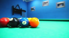 Colorful billiard balls on pool table. Billiards pool game. Billiard table. Colorful billiard balls on pool table. Billiards pool game. Green cloth table with stock video footage