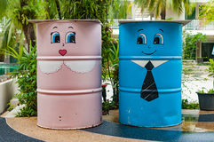 Colorful bin in a garden with cartoon painted Stock Photo