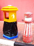Colorful of bin. On sidewalk, yellow, red, pink, blue, black and white Royalty Free Stock Images