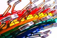 Colorful binder clips. Red, yellow, green, and blue binder clips in rows Royalty Free Stock Photos