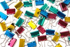 Colorful binder clips background. Royalty Free Stock Photography