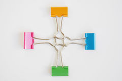 Colorful binder clips. On white background Royalty Free Stock Photo