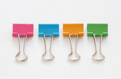 Colorful binder clips. On white background Royalty Free Stock Images