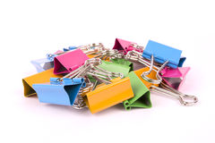 Colorful binder clips on white background Stock Photos