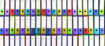 Colorful binders. Colorful office folders. Stock Photos