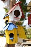 Colorful bird house. Stock Photos