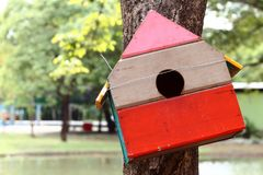 Colorful bird house. On the tree royalty free stock photography