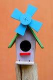 Colorful bird house. On orange background royalty free stock image