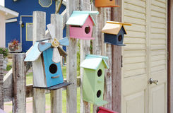 Colorful bird house on the timber fence Royalty Free Stock Photography