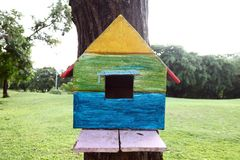 Colorful bird house. On the tree stock images