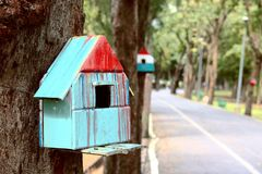 Colorful bird house. On the tree stock photography